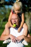 Feeding Daddy Royalty Free Stock Photography