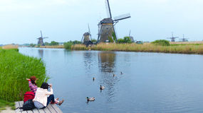 Feeding the ducks at Kinderdijk Royalty Free Stock Images