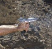 Feeding handgun Stock Photo