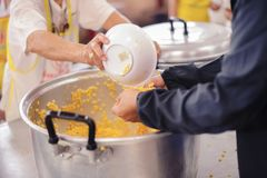 Feeding helps eliminate the hunger of many people.  royalty free stock image