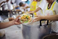 Feeding helps eliminate the hunger of many people.  royalty free stock photos