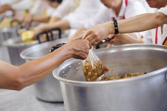 Feeding helps eliminate the hunger of many people.  royalty free stock images