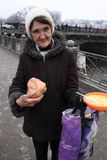Feeding of the homeless. KHARKIV, UKRAINE - MARCH 13, 2016: Some anarchist activists and anarcha-feminists adherents held next FNB Food No Bombs campaign feeding Stock Image