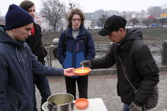 Feeding of the homeless. KHARKIV, UKRAINE - MARCH 13, 2016: Some anarchist activists and anarcha-feminists adherents held next FNB Food No Bombs campaign feeding Stock Images