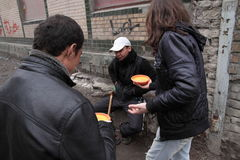 Feeding of the homeless. KHARKIV, UKRAINE - MARCH 13, 2016: Some anarchist activists and anarcha-feminists adherents held next FNB Food No Bombs campaign feeding Stock Photography