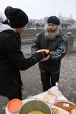 Feeding of the homeless. KHARKIV, UKRAINE - MARCH 13, 2016: Some anarchist activists and anarcha-feminists adherents held next FNB Food No Bombs campaign feeding Royalty Free Stock Photography
