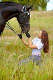 Feeding horse Stock Photo