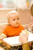 Feeding a little baby boy Royalty Free Stock Photography