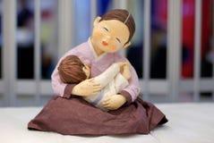 Feeding Mother Stock Image