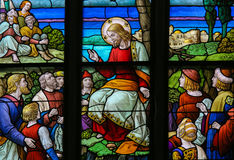 Feeding the multitude - Stained Glass depicting the Miracle of t. Stained Glass window depicting the miracle of Jesus feeding the multitude with loaves of bread Royalty Free Stock Image