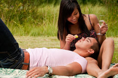 Feeding my boyfriend with a grape Stock Image