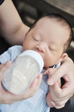 Feeding newborn baby boy Stock Images