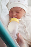Newborn girl in the maternity hospital Stock Images