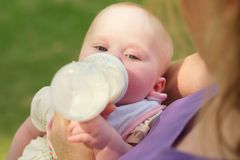 Feeding newborn daughter Stock Photo
