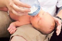 Feeding newborn Stock Images