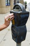 Feeding the parking meter Royalty Free Stock Images