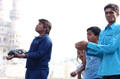Feeding the pigeons near Charminar Stock Images