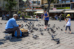 Feeding pigeons at Ortakoy in Istanbul in Turkey. Stock Photo