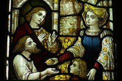 Feeding the poor (good deed) in stained glass Royalty Free Stock Photos