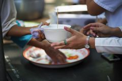 Feeding the poor Helping each other in society.  Royalty Free Stock Photography
