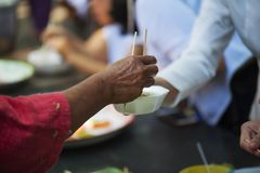 Feeding the poor Helping each other in society.  Royalty Free Stock Images