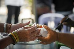 Feeding the poor Helping each other in society.  Royalty Free Stock Image