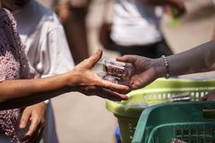 Feeding the poor Helping each other in society.  Stock Image