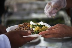 Feeding the poor Helping each other in society.  Royalty Free Stock Photos