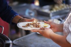 Feeding the poor Helping each other in society.  Royalty Free Stock Photo