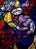 Feeding the poor in stained glass Stock Photo