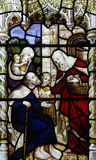 Feeding the poor (stained glass) Stock Photography