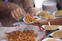 Feeding the poor to help each other in society. Charity concept.  Royalty Free Stock Photos