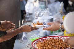 Feeding the poor to help each other in society. Charity concept.  Royalty Free Stock Photography