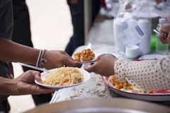 Feeding the poor to help each other in society. Charity concept.  Stock Photography