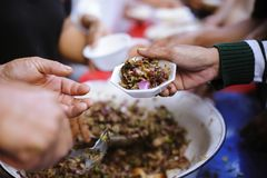 Feeding the poor to help each other in society : concept of donation stock photo