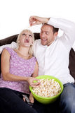Feeding popcorn Royalty Free Stock Images