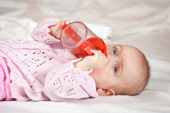Feeding procedure of little baby Stock Image