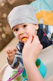 Feeding of a small child Stock Photo
