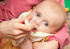 Feeding of a small child Stock Photo