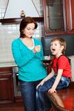 Feeding a son Stock Photos