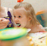 Feeding soup to small kid with appetite Stock Image