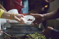 Hands of the poor receive food from the donor`s share. poverty concept. Feeding to hand the poor helping beggar in social. poverty concept royalty free stock photos