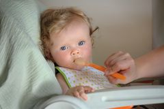 Feeding up of little cute baby girl Stock Photo