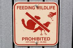 Feeding Wildlife Prohibited posted sign in Shoreline Lake and Park, Mountain View, California royalty free stock photography