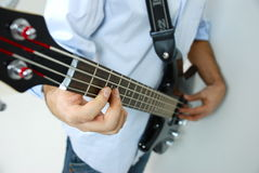 Feel the bass. Playing the black bass on white background royalty free stock photos