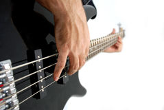 Feel The Bass. A hand playing a bass guitar Stock Images