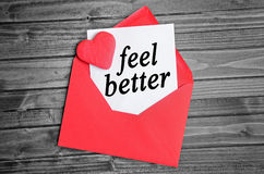 Feel better word. On white paper stock photo