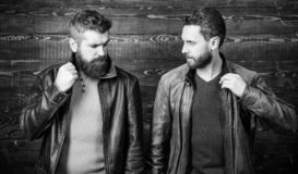Feel confident in brutal leather clothes. Brutal men wear leather jackets. Leather fashion menswear. Men brutal bearded stock photography