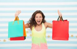 Feel free buy everything you want. Woman carries bunch shopping bags striped background. Finally bought favorite brand. Tips shop sales. Girl satisfied with royalty free stock photo