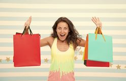 Feel free buy everything you want. Woman carries bunch shopping bags striped background. Finally bought favorite brand. Tips shop sales. Girl satisfied with royalty free stock images
